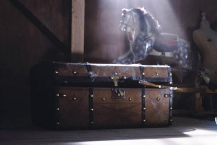*Up in the attic of the asylum there is a dusty old trunk which no one dared to get near. It has bee