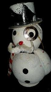 *Apple gets started with her entry for the snowman contest. She rolls up a large snowball and then a