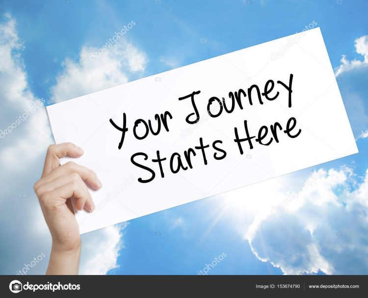 Your Journey Starts Here Sign on white paper. Man Hand Holding P