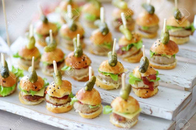 *Mini Burgers* Delicious one bite mini burgers served on a party or wedding reception.