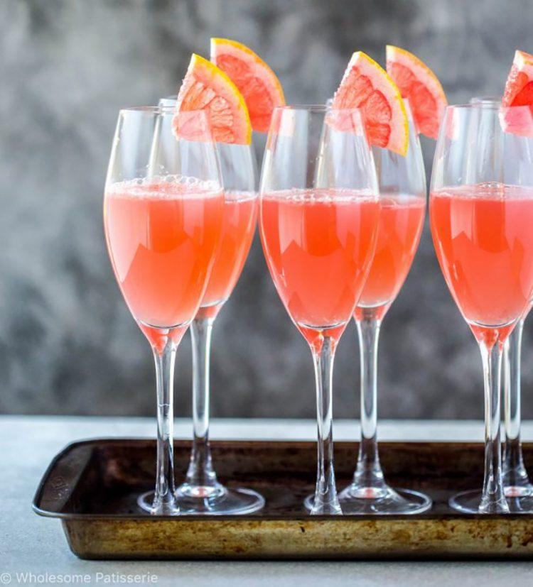 *Carefully begins setting up some mocktails along the banquet tables.* pink-grapefruit-sours-mocktai