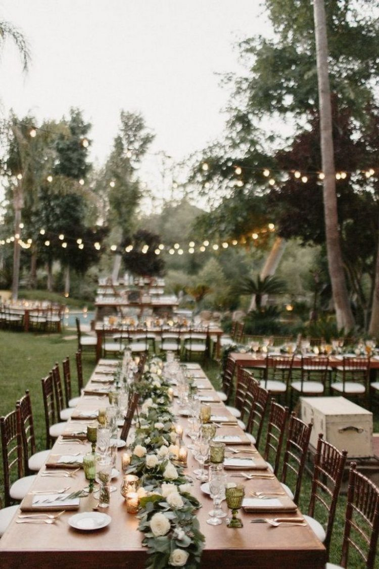 *Setting up more chairs in the large backyard for guests to enjoy the bbq.* 40-Nice-backyard-Wedding
