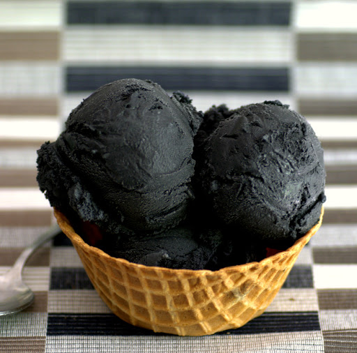 *She laughs as she sees the black ice cream.* Ok! I have to taste this! Can't deny what the cu