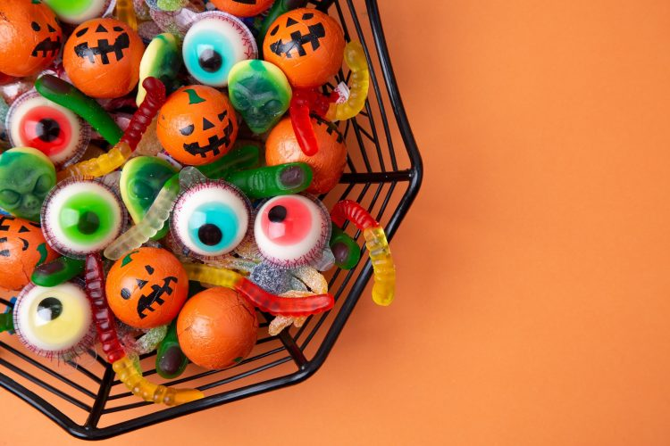 **funny-haloween-candy-in-a-spiderweb-bowl-royalty-free-image-1602611912
