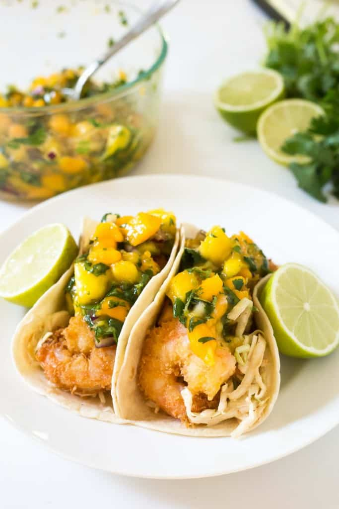 *She giggles* Perfect! Here are the Tropical Shrimp Tacos. I think we'll have to taste test th