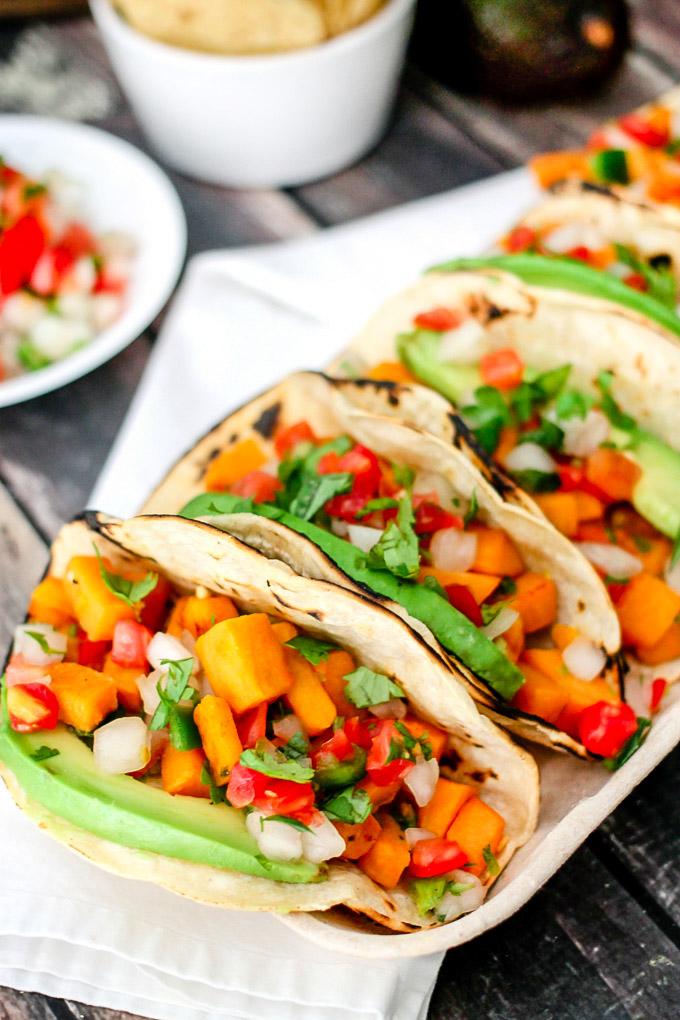 *She brings over their order of veggie tacos* Vegetarian-Tacos-3