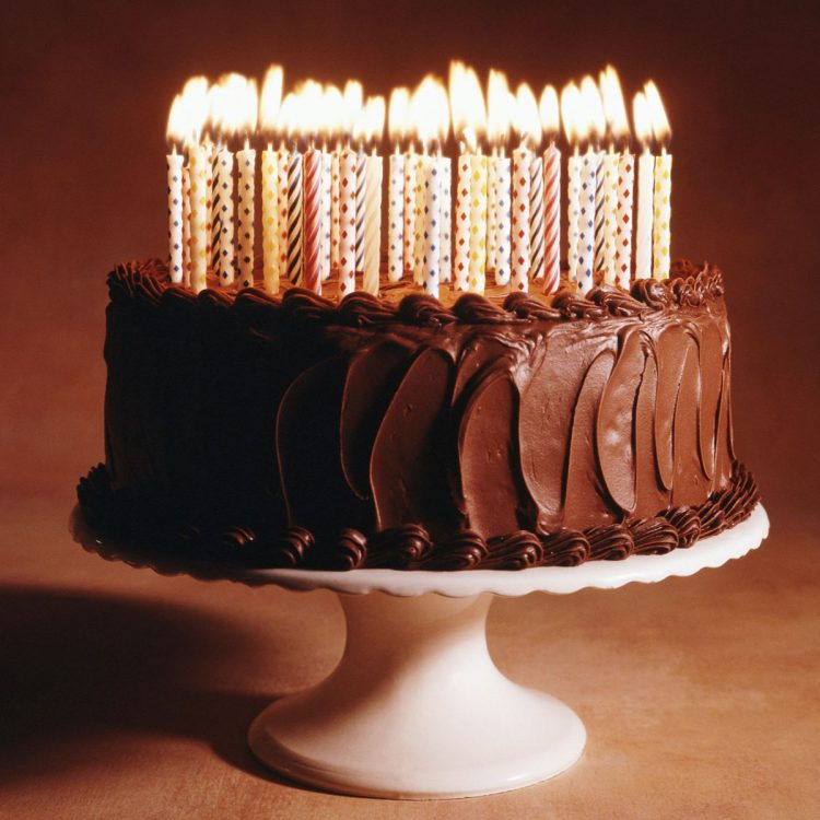 *Brings in the cake from SugarSweet Bakery and starts putting candles on it.* Hmm well, since the bi