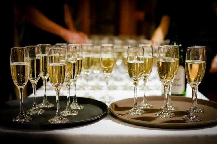 *He makes sure there are plenty of champagne glasses available for the guests* drinks-1283608_1280