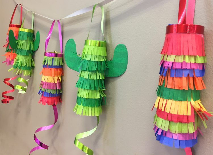 *Brings over the piñatas from the candy shop and blends a couple of old world culture celebrations,